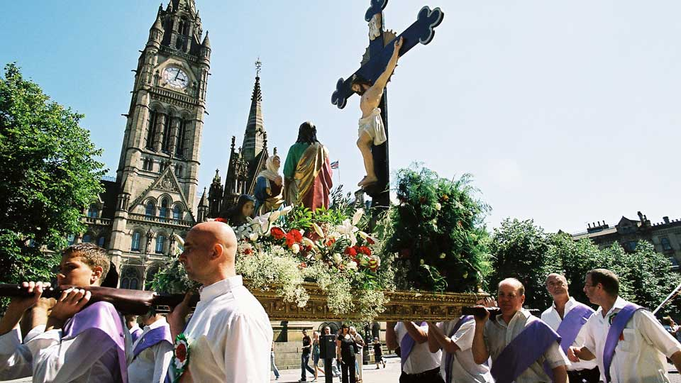 Carrying the emblems at the Madonna del Rosario Procession, Manchester